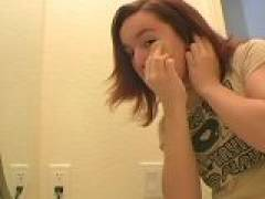 Lovable redhead teen Annabella getting ready for you in the mirror